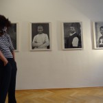 dancer oxana chi is dancing in front of the photographs of zanele muholi
